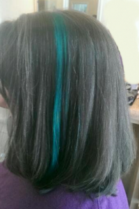 Cool blue streak in dark hair